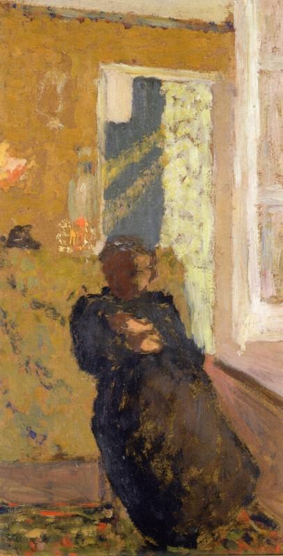 Сидящая женщина в чёрном