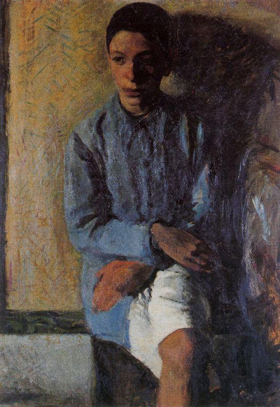 Сидящий молодой человек